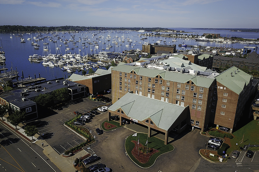 Aerial photo of the Newport Marriott hotel right along the Newport Habor