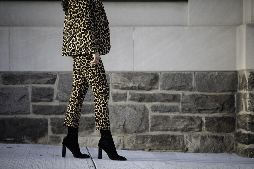Liv Micheli is in Greenwich, CT wearing the Frame Cheetah Velveteen Classic Blazer, Frame Cheetah Velveteen Flare pants, Are You Am I Ling Top, Vintage Gold Mesh Belt from Etsy, and Public Desire Velvet boots.